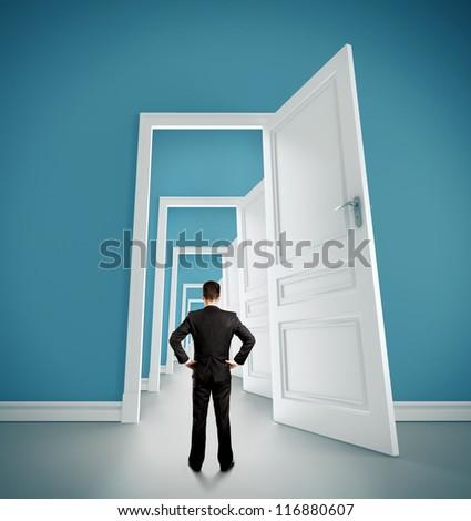 man in blue room with doors open