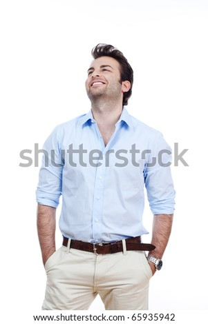 man in blue shirt and light trousers standing, smiling- isolated on white