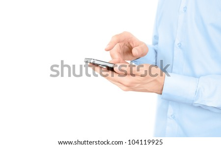 Man in blue shirt holding and touching on modern mobile smart phone. Isolated on white. Copy space added.