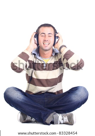 man in blue shirt with earphones listening to music - isolated on white