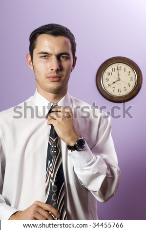 Man in business attire standing near wall clock � he is too late !