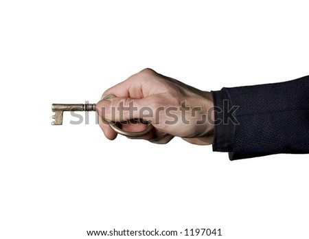 Man in business suit holding an antique key - stock photo