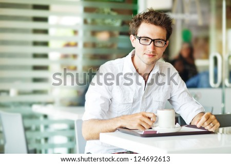 Man in cafe with coffee