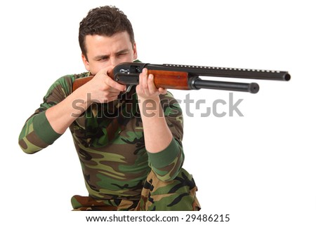 man in camouflage aims by gun - stock photo