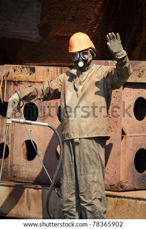 Man in chemical protection suit waving hand
