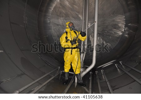stock-photo-man-in-chemical-suit-inside-