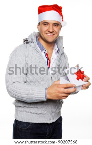 Man in christmas hat holding christmas present - stock photo