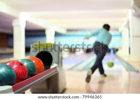Man in club for bowling throw ball