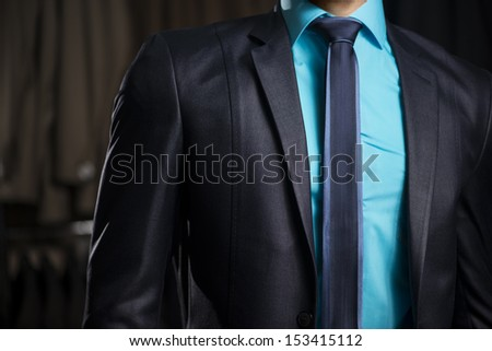 Man in Elegant Business Man Suit at Men Fashion Shop