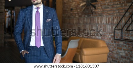 Man in expensive custom tailored suit posing indoors #1181601307