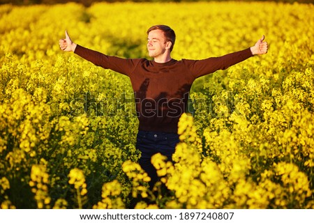 man in field blowing his nose and suffering from hay fever. Stock photo ©