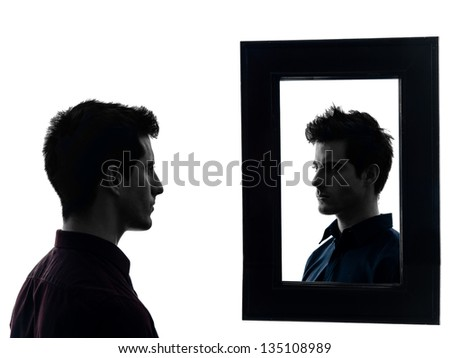 man in front of his mirror  in shadow  white background ストックフォト ©