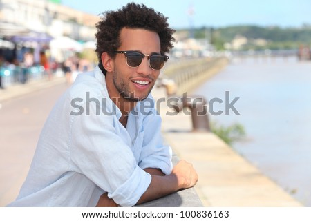 Man in front of the river dock