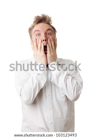 Man in frustration, anger or similar strong emotion and screaming isolated on white