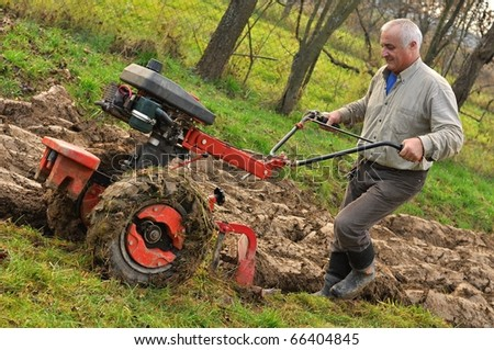 man in garden with tractor #66404845