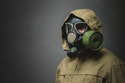 Man in gas mask close up on gray background.