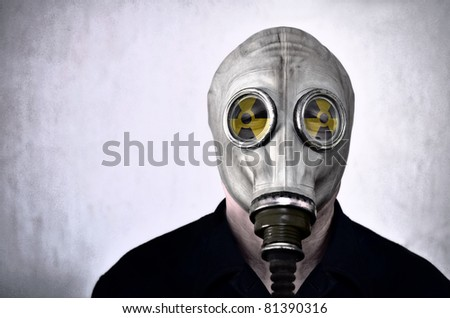 Man in gas mask, photo in grunge style, nuclear warning