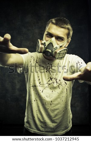Man in gas mask posing over grunge background