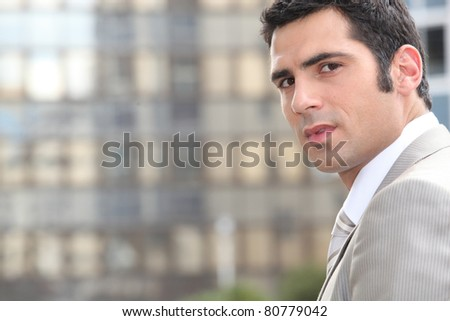 Man in gray suit outdoors