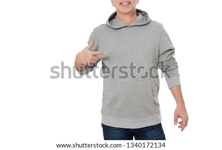 Man in gray sweatshirt point template background on clothes isolated. Male sweatshirts set with mockup and copy space. Hoody design. Hoodie front cropped image view. Closeup