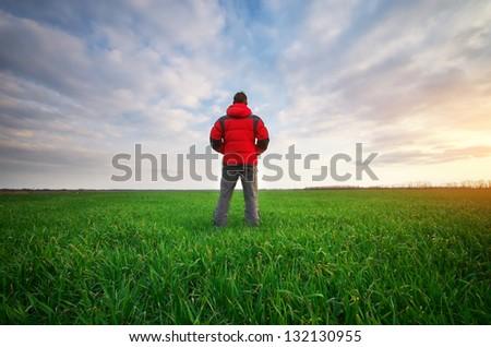 Man in green meadow. Conceptual scene. #132130955