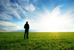 Man in green meadow. Element of design.