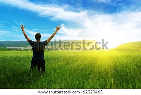 Man in green meadow. Emotional scene. #62020465