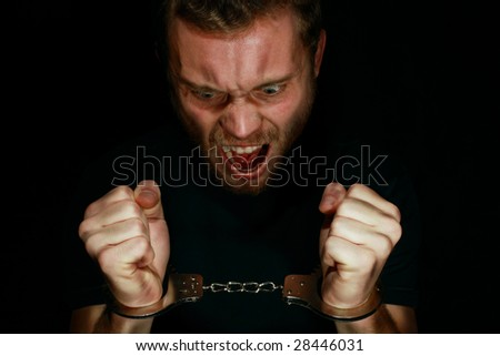 Man in handcuffs angry