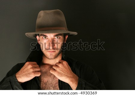 Man in hat and trench coat