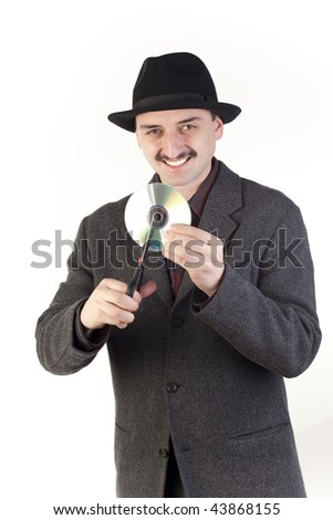 Man in hat cutting a compact disc
