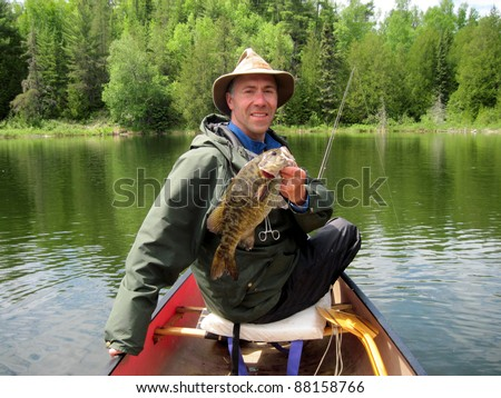 man in hat fishing