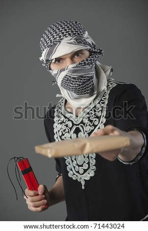 man in headscarf holding letter and dynamite