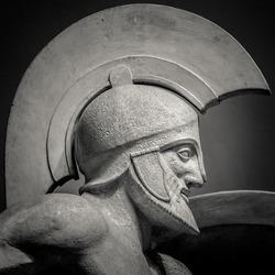 Man in helmet Greek ancient sculpture of warrior