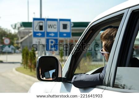 Man in his car stops at petrol station