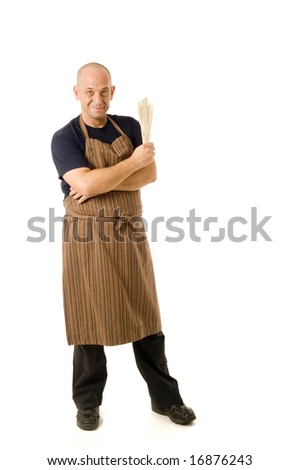 man in his 40's with apron and cooking utensils isolated on white