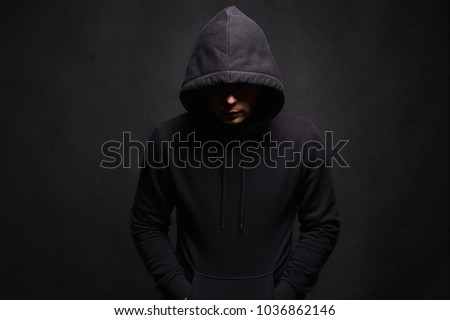 Man in Hood. Dark figure in a hooded sweatshirt. Incognito Boy