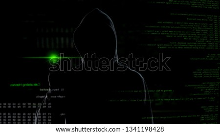 Man in hood push button on virtual screen with scripts, anonymous cyber attack