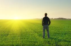 Man in meadow green meadow. Conceptual scene.