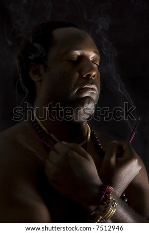 Man in meditation isolated on black