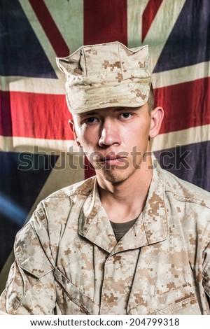 Man in military uniform on UK flag background