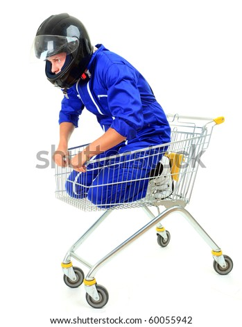 man in motorcycle coveralls and helmet siting in shopping cart