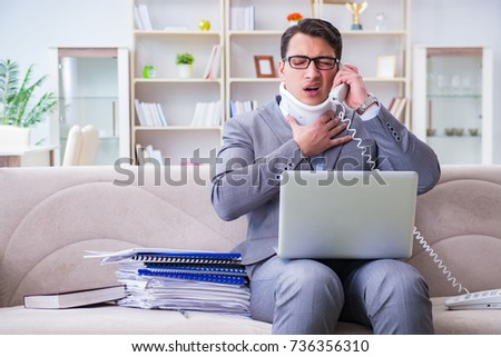 Man in neck brace cervical collar working from home teleworking #736356310