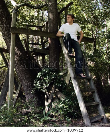 man in old treehouse