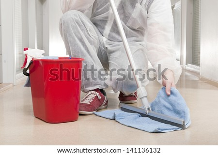 Man in Overall Cleansing Spatula with Towel