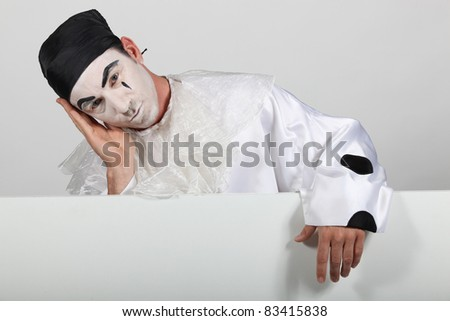 stock photo man in pierrot costume with a board ready for your text 83415838  s anal punishment.jpg