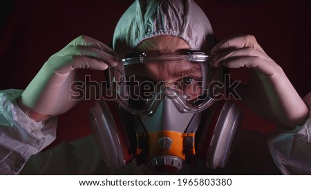 Man in protective costume suit, gas protect medical spray paint mask. Doctor in respirator. Concept health virus coronavirus epidemic. Stok fotoğraf ©