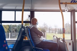 Man in protective medical mask in bus. Public transport during coronavirus covid-19 pandemic,