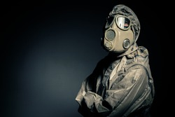 Man in protective suit against black background