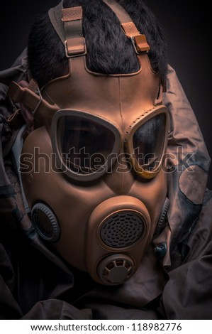Man in protective suit against dark background