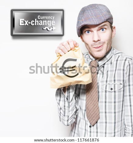 Man In Recession Clothing Holding Bag Of Euro Currency At Money Exchange In A Depiction Of The European Sovereign Debt Crisis Or Eurozone Crisis